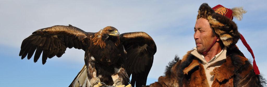 mongolian hunter holding eagle