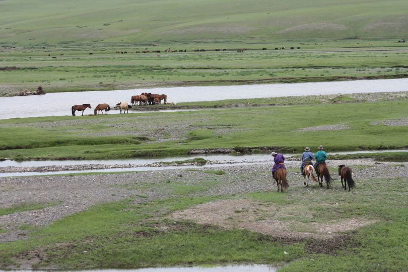 nomads riding in the countrside